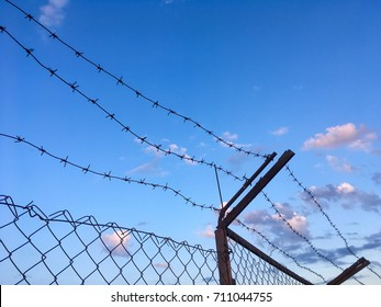Razor Barbed Wire Against Blue Sky Stock Photo (Royalty Free ...