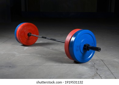 Barbell bar and barbell plate on black background