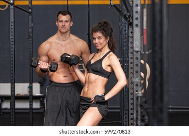 Barbell training man and womanin a gym