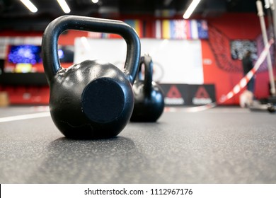 barbells and dumbbells in gym