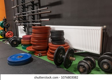 Barbells and dumbbells on the floor in the gym for strength fitness workout