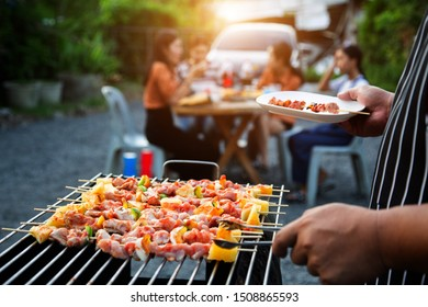 Barbeque Grill Street Food in thailand,Eat outdoors in a happy family. holiday celebration concept