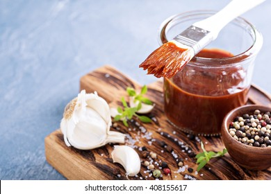 Barbeque sauce with a basting brush in a jar