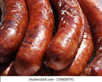 Barbequed farmer sausages on the white plate