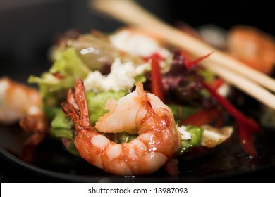 Barbequed prawn salad with shrimp lettuce and green lime, macro closeup with copy space
