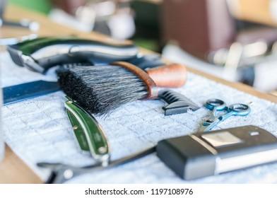 Barber accessories in barbershop. Closeup shot of accessories in man salon.