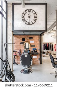 Barber chair in a retro beauty salon. Male hair salon and beard product store, barber shop and manicure interior business