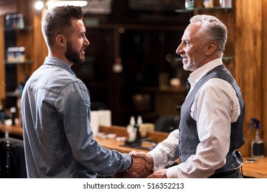 Barber and client shaking hands