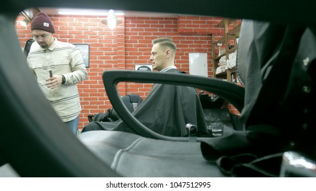 Barber cuts the hair of the client with scissors 4k