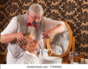 Barber cutting the mustache of a customer in an antique victorian barbershop (the antique magazine is from 1910).