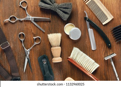 Barber Equipment And Tools On Wood Table