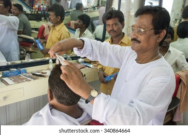 Barber giving a haircut - MAY 20th 2015; JEYPORE - INDIA