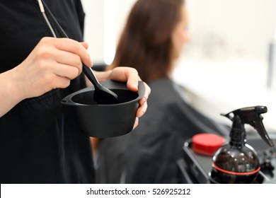 Barber hair dye is applied with a brush