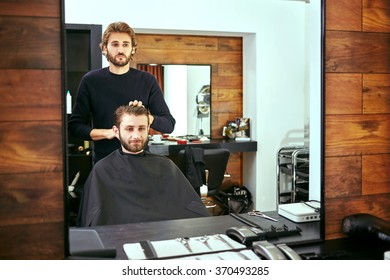 Barber makes men haircut at the beauty salon