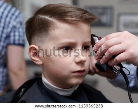 Barber Making Haircut Boy Clipper Stock Photo Edit Now 1159365238