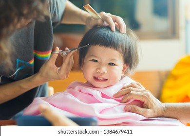 A barber is a person whose occupation is mainly to cut, dress, groom, style and shave men's and boys' hair. A barber's place of work is known as a barbershop. this girl is cut her hair at her home.