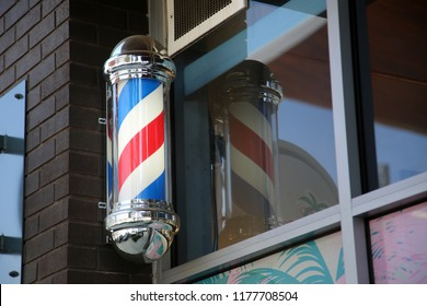 barber pole. red white and blue barber pole. hair salon. barber shop