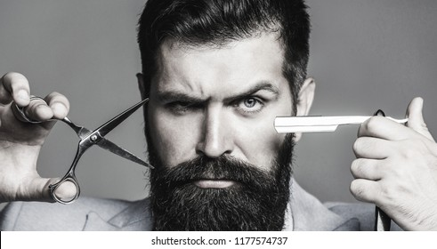 Barber scissors and straight razor, barber shop, suit. Beard man, bearded male. Portrait beard man. Vintage barbershop, shaving. Mustache men. Brutal guy, scissors, straight razor. Black and white.