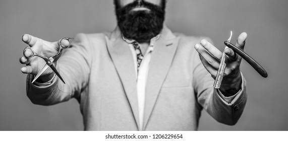 Barber scissors and straight razor, barber shop. Male in barbershop. Mens haircut in barber shop. Mens haircut, shaving. Bearded man, long beard, brutal, caucasian hipster with moustache. Isolated.