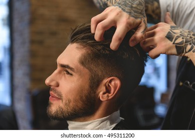 barber scratching head of a customer