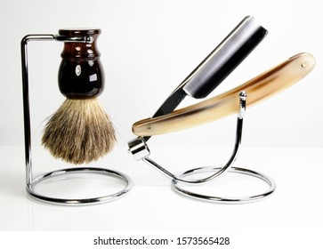 Barber Set with Straight Razor and Lather Brush. Men's vintage wet shaving equipment brush and razor in a stand.