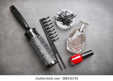 Barber set with with tools and cosmetic on grey background