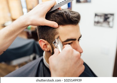 Barber shave and modeling beard at the hair salon