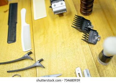Barber shop tools on wood background with place for text. Copy space. Selective focus.