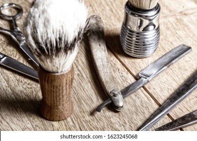 Barber shop vintage equipment tools Brush Razor Hair Trimmer Old used metal scissors Man hairdresser from the past Man hair stylist Beard trimming Metal parts on wooden background Steel and iron pi