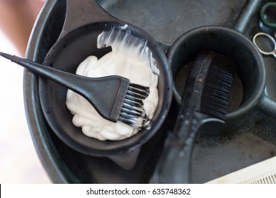Barber supplies, applying color cream at hair.