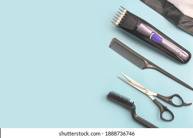 barber tools on blue background. hair clipper, comb, scissors and brush. man hair stylist equipment. male beauty care. home hair cut tools. hairdresser electric machine.