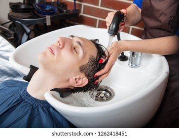 Barber at work. Man at barbershop