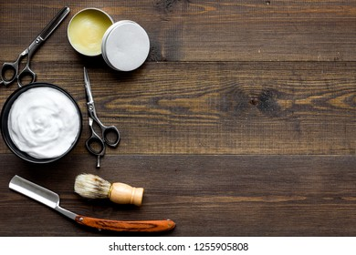 barber workspace in barbershop with equipment wooden background top view space for text