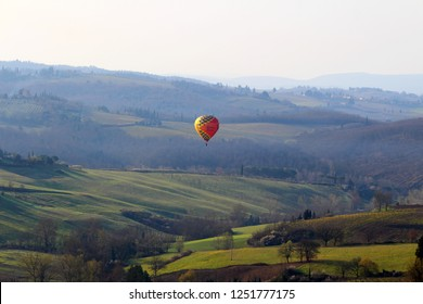 Barberino Val d'Elsa, Tuscany, Italy - March 2016. A hot air balloon at sunrise above the Chianti hills south of Florence in Tuscany