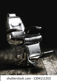 Barbershop armchair, modern hairdresser and hair salon, barber shop for men. Barber shop chair. Stylish vintage barber chair. Hairstylist in barber shop interior. Black and white.