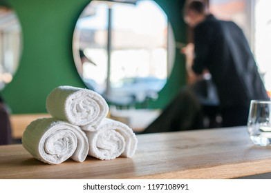 Barbershop background theme. Barber working in barbershop and cutting client's hair.