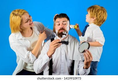 Barbershop. Barber shop tools. Hairdresser making hairstyle. Beard care. Hair preparation. Fashion. Bearded man in barbershop. Coiffeur making hairstyle. Scissors.