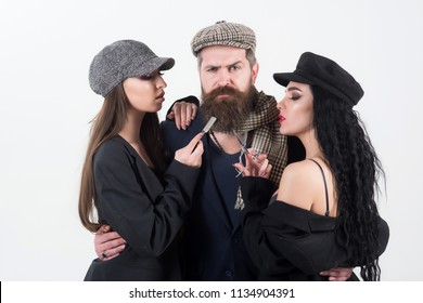 Barbershop. Bearded man with couple of women holding barber tools, barbershop. Barbershop or barber shop. Barbershop for real man.