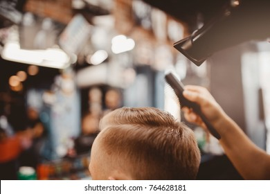 Barbershop. Close-up of a man's haircut, master Barber Shop does the hair styling