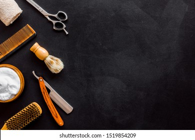 Barbershop concept. Hairdressing tools on black background top view space for text