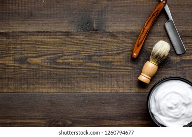 barbershop desk with tools for male care wooden background top view mock-up
