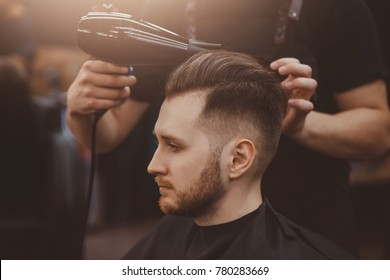Barbershop. Man with beard in barber shop. Modern hair salon
