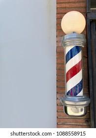 Barbershop Pole, isolated, on Brick Wall