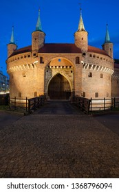 Barbican at night in Old Town of Krakow, Poland, part of the old city wall fortification, fortified outpost from 15th century.