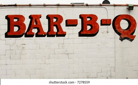 A Bar-B-Q sign on the side of a building