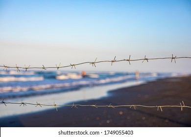 Barbwire fence blocking the way to the sea side due to Coronavirus pandemic