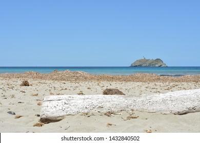 Barcaggio beach and Giraglia island. Cap Corse, Corsica, France