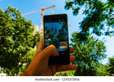 Barcellona, Spain 07 September 2018:  A guy take a shoot of Nativity façade with the smarphone