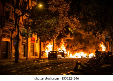 BARCELONA, SPAIN–October 16, 2019: A fire set by protesters engulfs cars in Barcelona. Demonstrations are ongoing following the sentencing of Catalan leaders over the 2017 independence referendum.