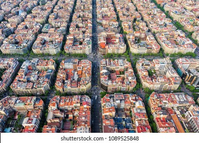 Barcelona aerial view, famous Eixample residencial district urban forms, Spain. Late afternoon light